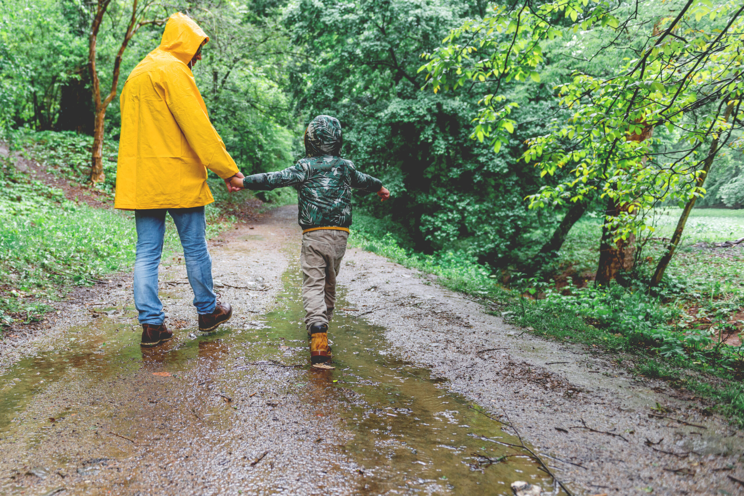 Father and son walking in the rain